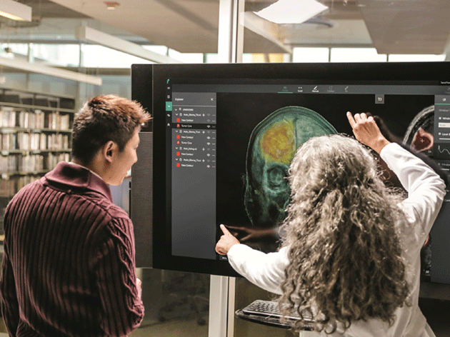 Two healthcare workers looking at an xray image